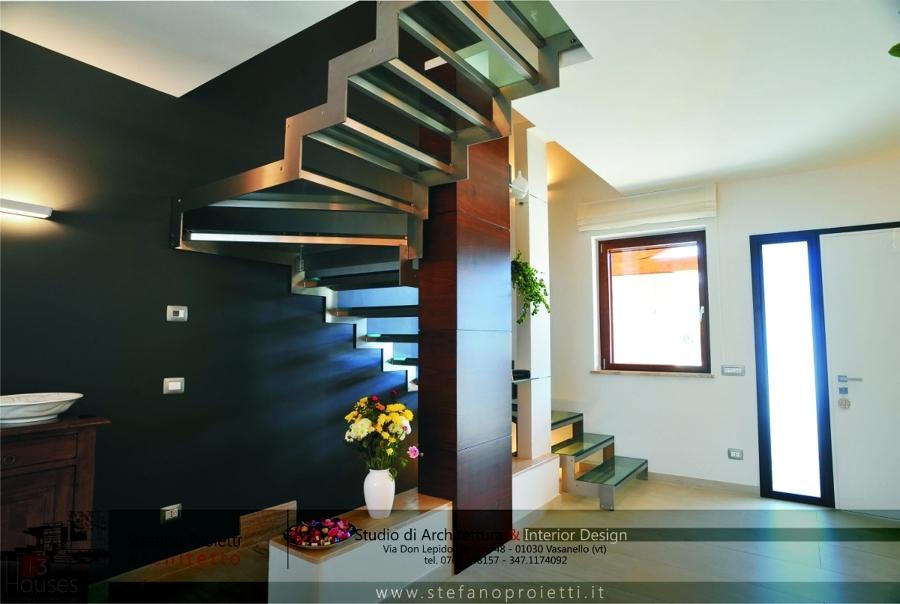 Progetto di un interno con camino centrale nella zona for Designer di interni