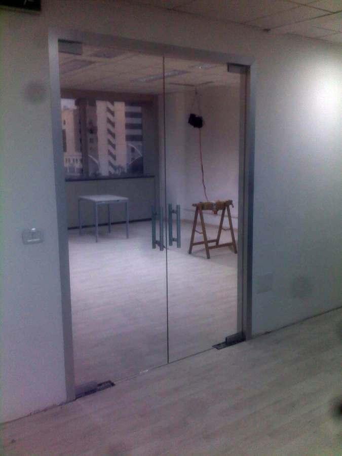 Doppia porta in vetro.