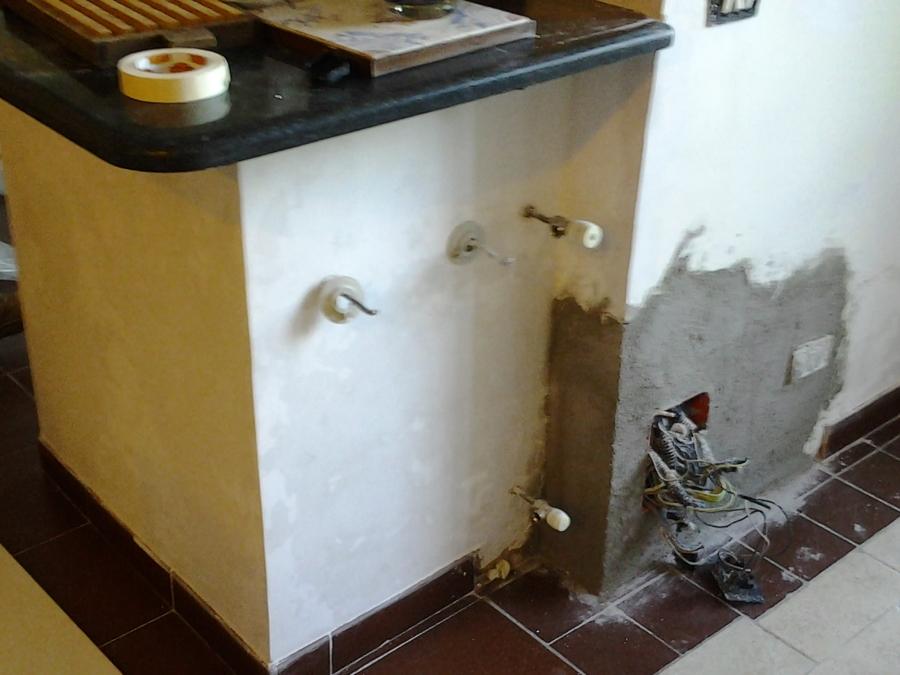 Impermeabilizzazione e intonacatura della muratura interessata dalla risalita dell'umidità