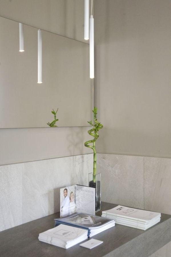 Ristrutturazione showroom atrio idee ristrutturazione casa for Luci bagno design