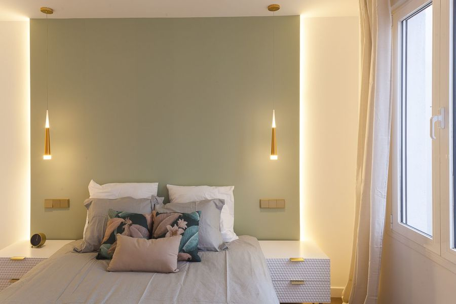 Parete verde camera da letto