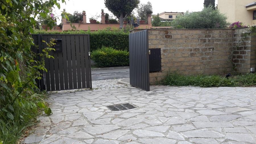 Patio esterno in porfido Roma;