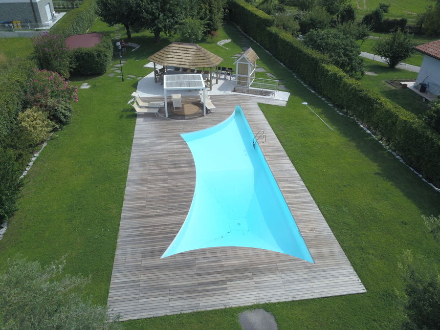 Foto piscina interrata con forma a vela di aquazzura - Piscina interrata piccola ...