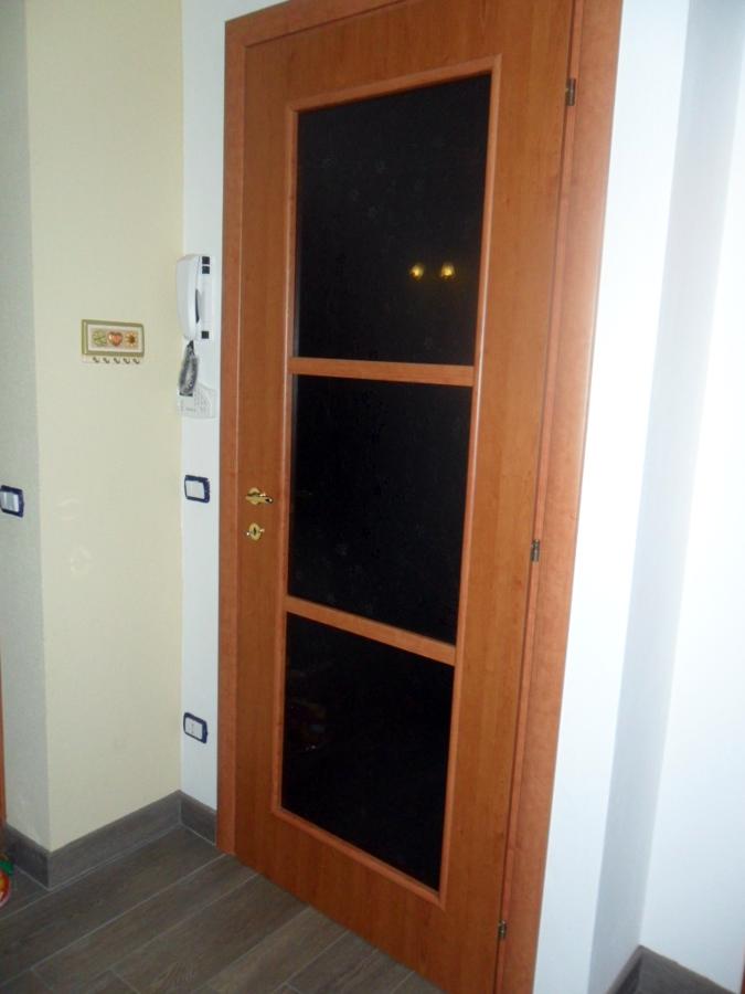 porta d'entrate a battente vetrata