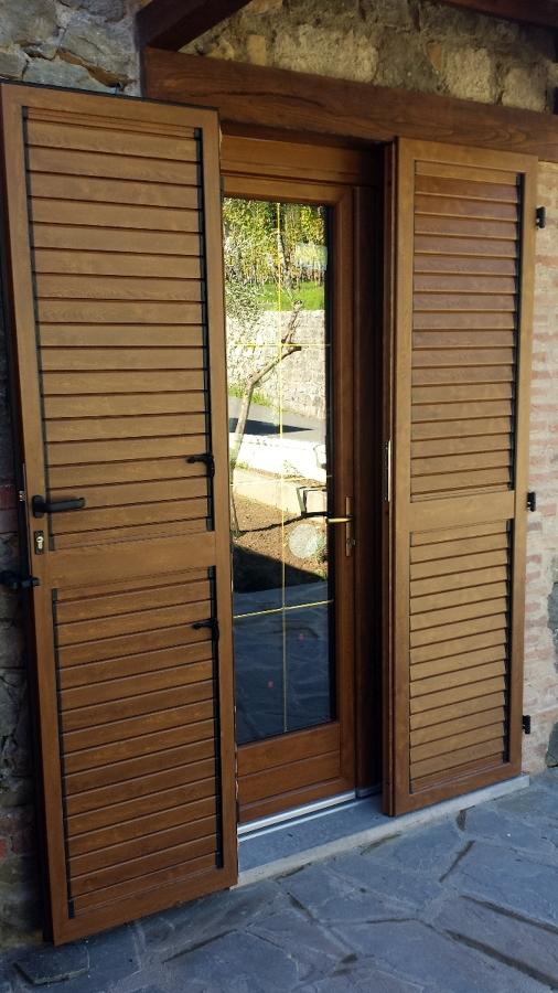 Foto porta finestra in pvc e persiana in alluminio de for Porta finestra pvc