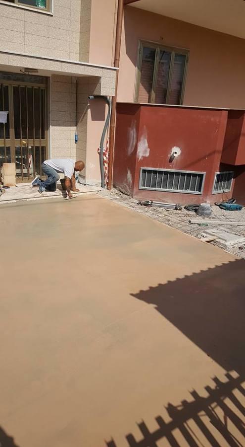 Rifacimento cortile in pavimento stampato con resina