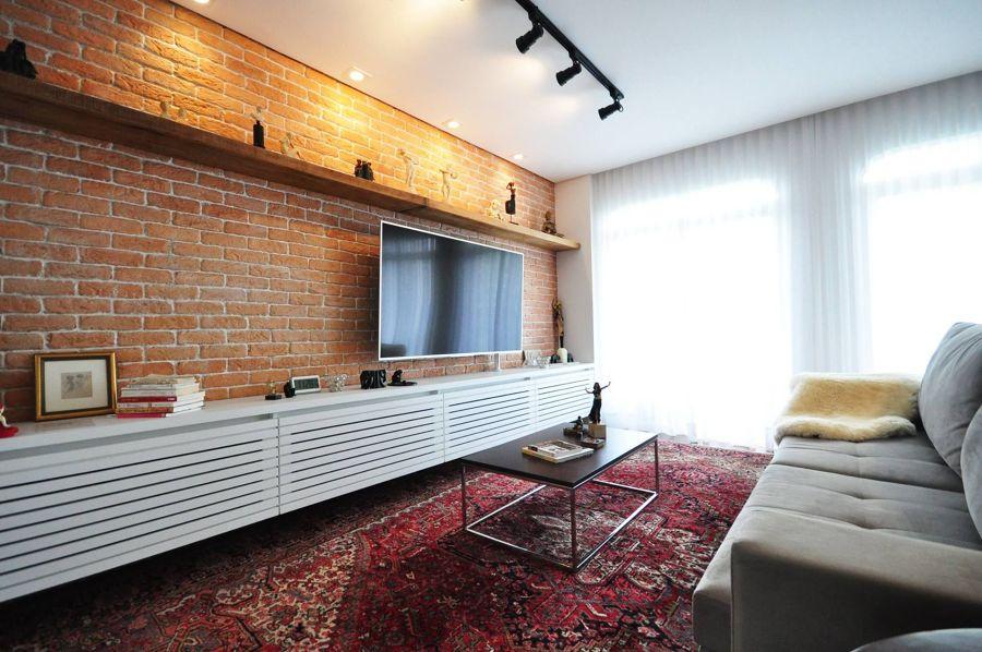 Salotto con parete in mattoni
