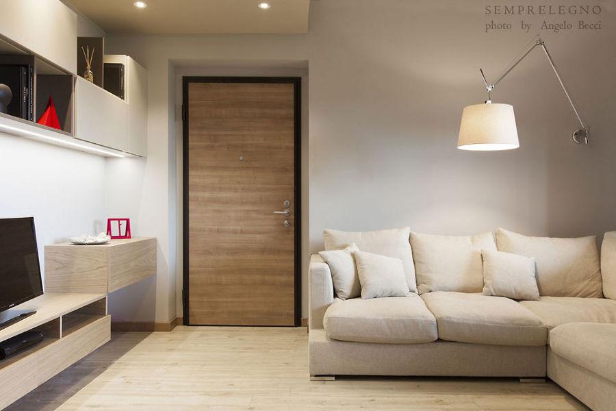 soggiorno design con cucina a vista e camera da letto