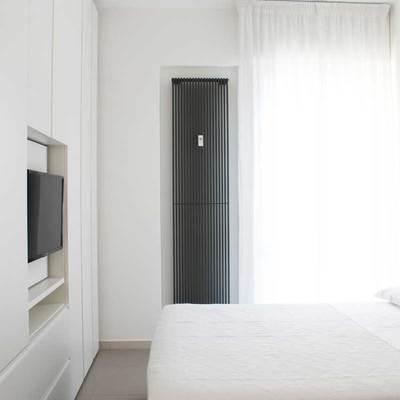 Ristrutturazione di appartamento con giardino in villetta trifamiliare