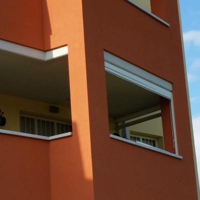 Chiusura balcone con tende in Cristal trasparenti