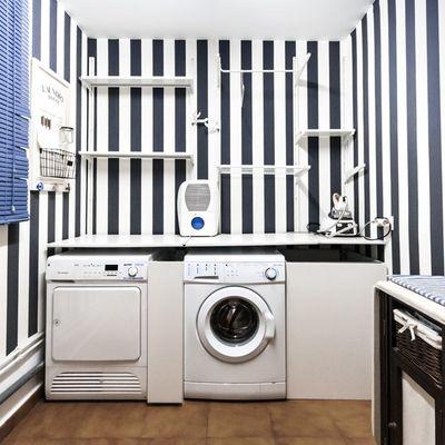 Idee per integrare una zona per lavare e stirare in casa