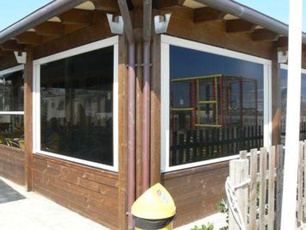 Foto chiusure invernali per logge e porticati di tekno - Chiusure per finestre in legno ...