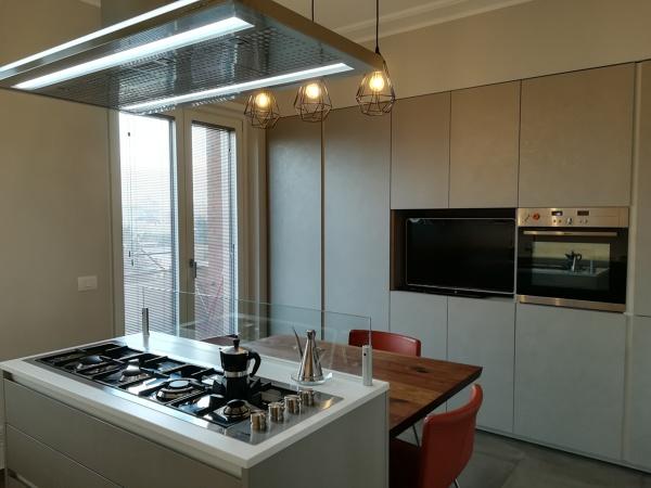 Foto: Cucina con Isola, Parete Attrezzata di A+A Architects ...