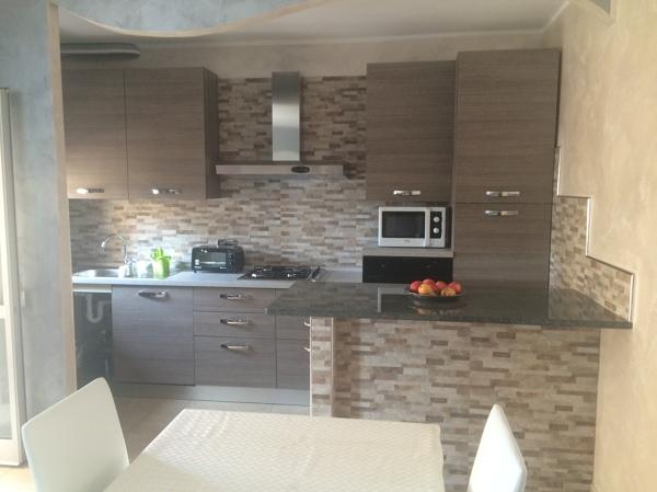 Foto: cucina open space collegata con la sala da pranzo di de castro