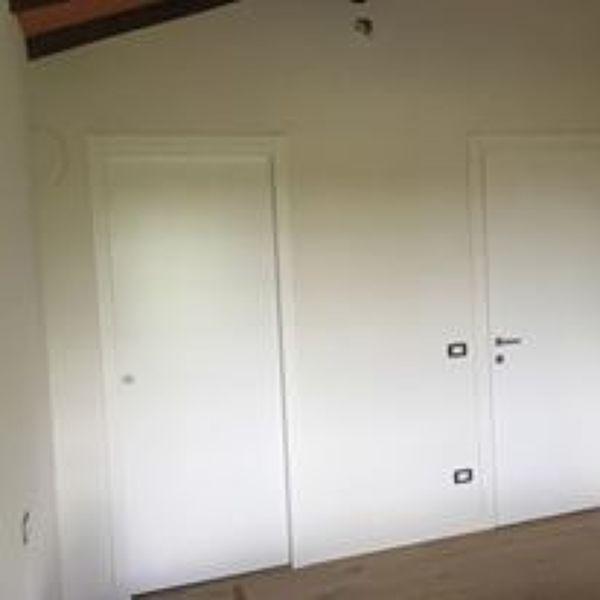 Foto porte interne laccate bianche di zero 5 di cosmai for Immagini porte interne