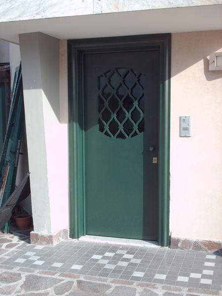 Foto protezioni per finestre e porte de edilsider sas di - Porte x cabine armadio ...