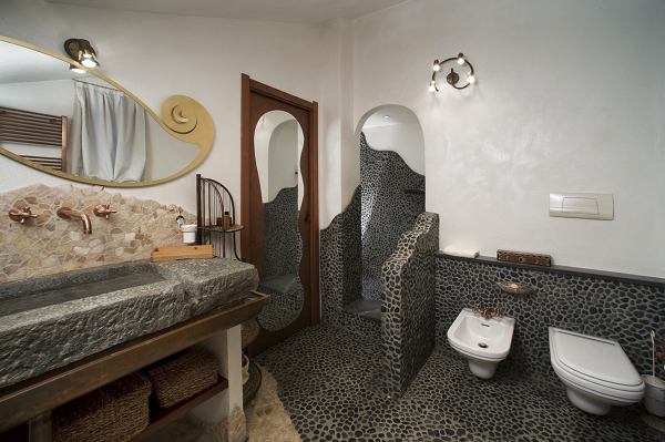 Progetto di realizzazione di bagno particolare con ciottoli di fiume