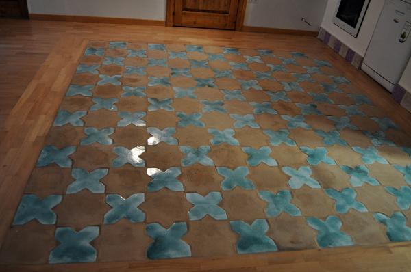 Foto tappeto di piastrelle di cotto artigianale stelle alternate