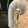 Bracciolo con finitura plisse' con borchie oro