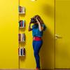 yellow wall with bookshelf