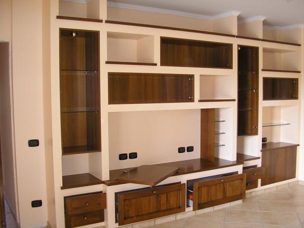 Parete attrezzata cartongesso e legno mobili soggiorno in - Porta tv in cartongesso ...