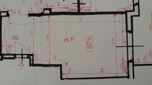 Come arredare l'area living con zona ingresso?