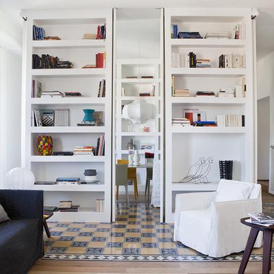 Parete libreria in cartongesso con porta scorrevole roma - Porta parete cartongesso ...