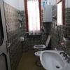 Ristrutturazione del bagno con reinstallazione caldaia elettrica dell'acqua calda, tinteggiatura pareti e soffitto