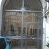 Sostituzione portone d'ingresso stabile condominiale