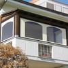 Chiusura balcone con tende antivento e antipioggia