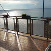 Sostizione vetri opachi con cristalli chiari su un balcone con infissi in alluminio anodizzato