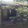 Chiusura veranda con pannelli in plastica a scorrimento tipo zanzariere