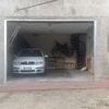 Realizzazione porta garage a due battenti