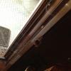 Riparazione portafinestra in legno con montante telaio forato