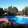 Ristrutturazione pavimentazione piscina 14m per 7m a forma di fagiolo