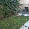Realizzazione di pavimentazione e aiule in piccolo giardino